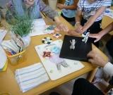 橋浦・相川小3年生体験学習で一緒に紙相撲